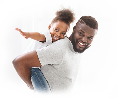 Image of father giving daughter piggyback ride