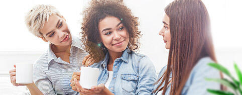 3 women enjoying coffee