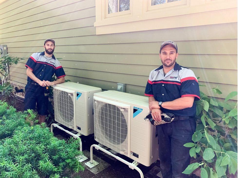 A1 Technicians servicing air conditioners