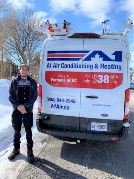 A1 Air conditioning & Heating van and technician image
