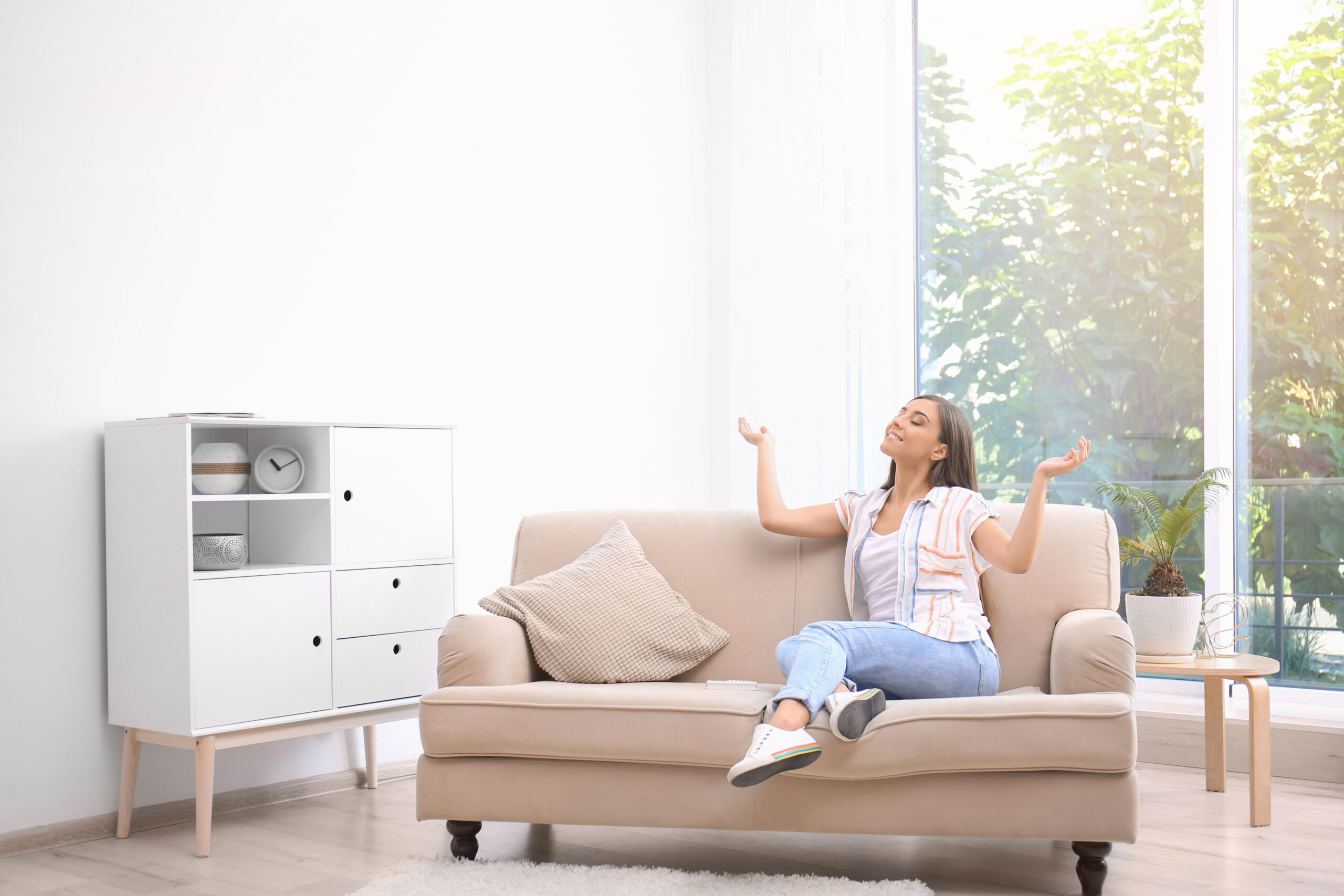 Woman on couch enjoying clean air