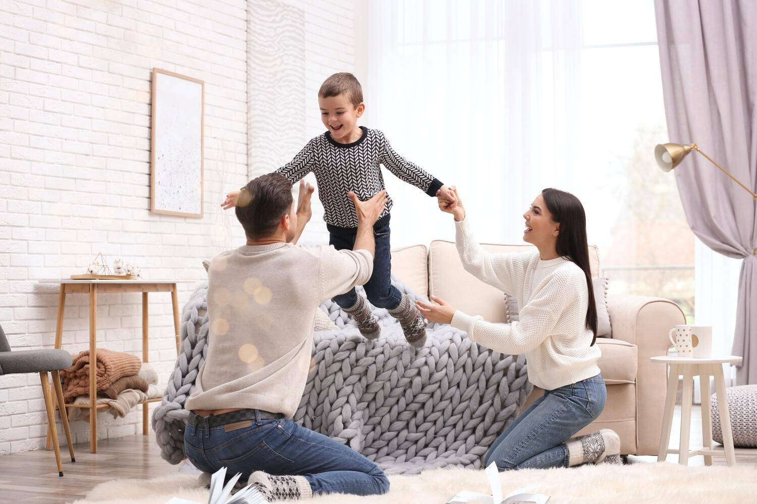 Family playing in living room daikin furnaces