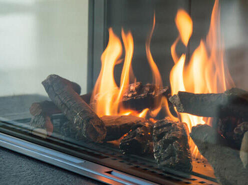 Fireplace with fire lit