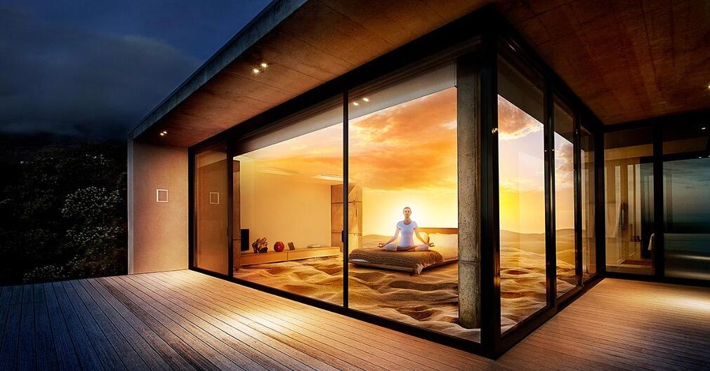 Image looking through glass windows into a bedroom with orange glow daikin furnaces